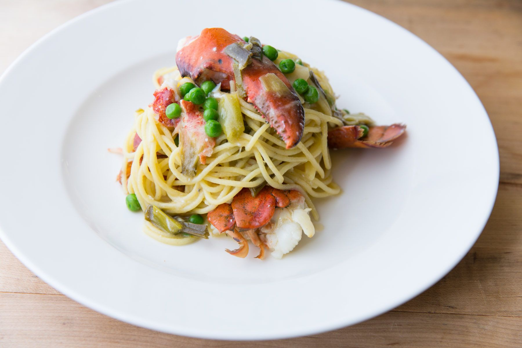 Lobster Spaghetti with Peas on a plate