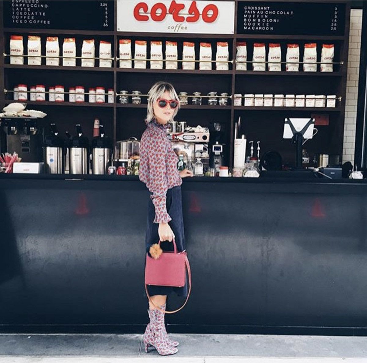 Girl standing at the counter of corso coffee