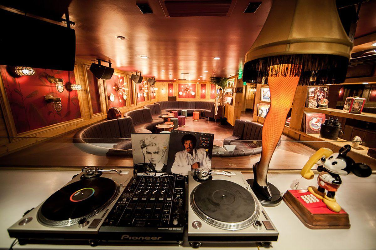 Vinyl DJ equipment and leg lamp at The Rec Room Miami