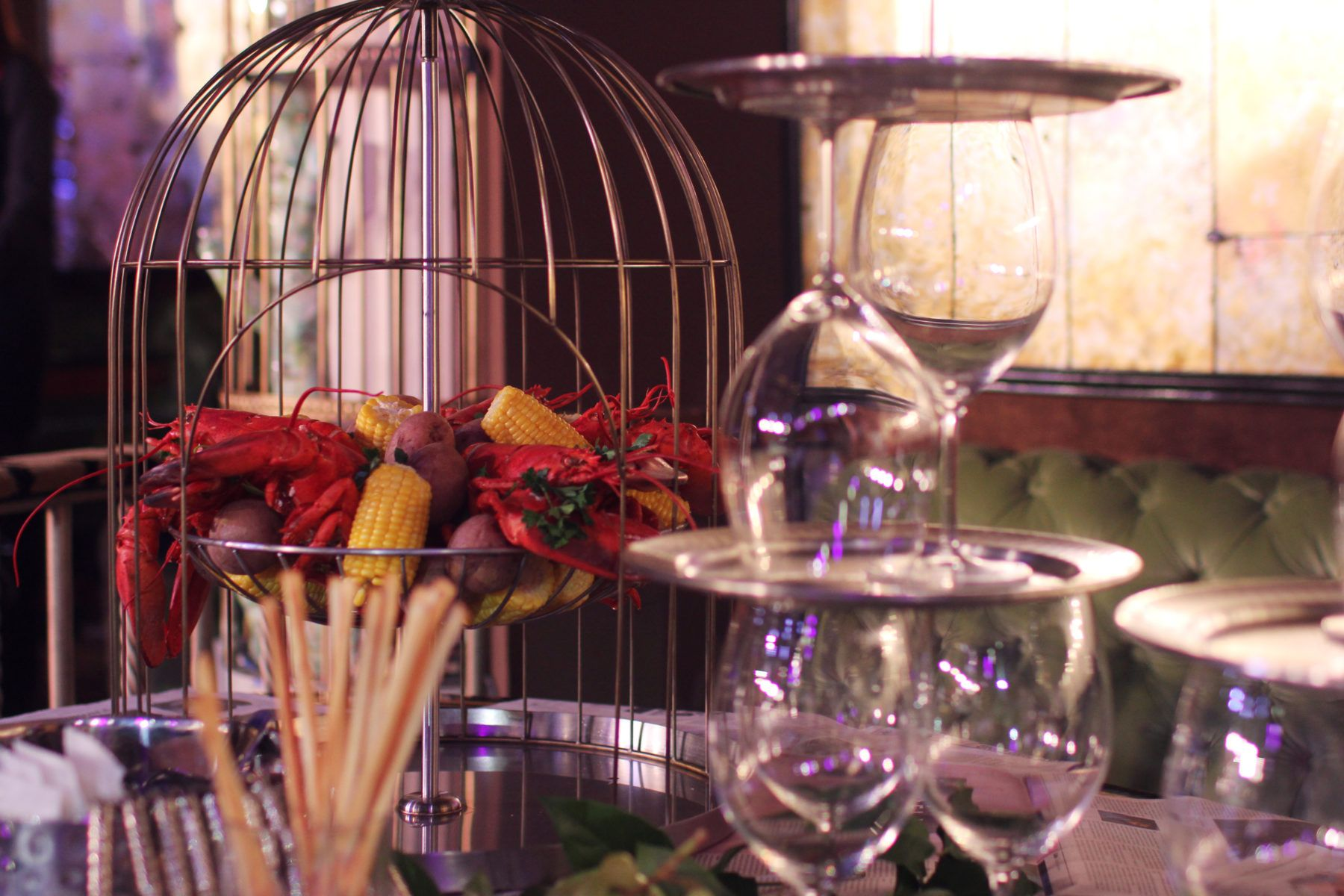 Lobsters and Corn in a cage on a table at The Diamond Horseshoe