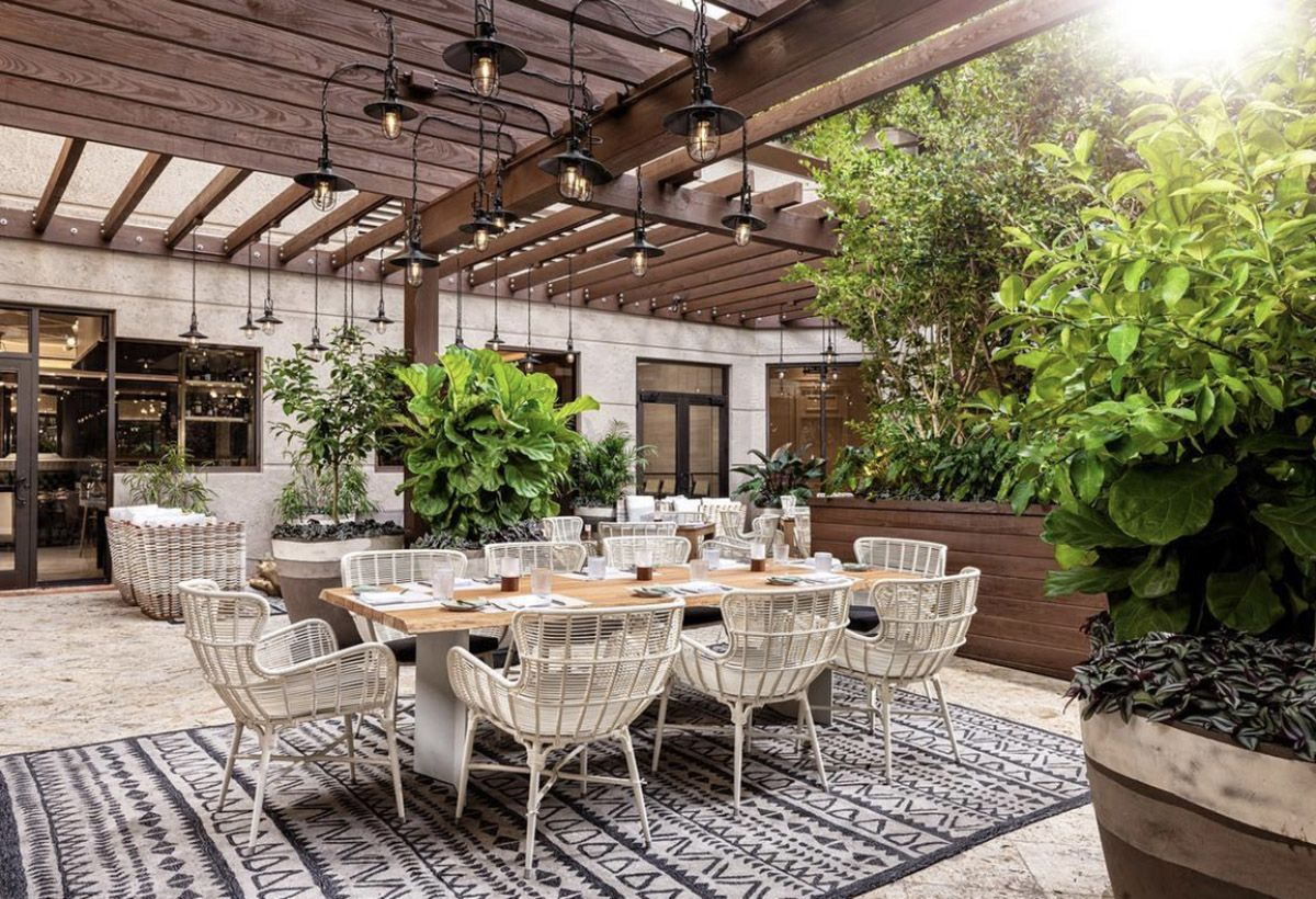 Outdoor garden dining area with palm trees