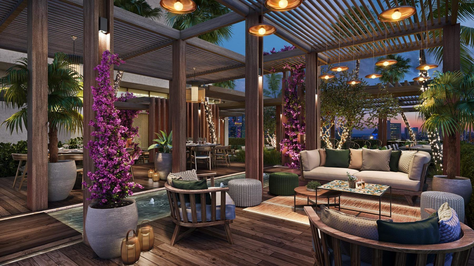 Rooftop dining lounge with sofas and palm trees