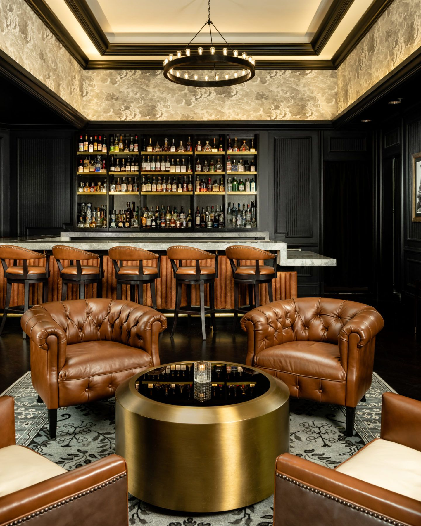 Bar view with bronze and leather furniture at The Commodore