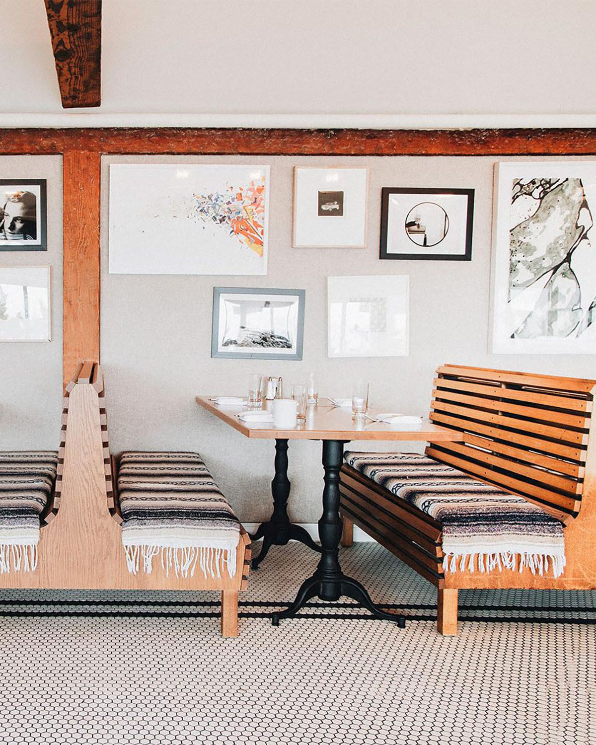 Wood benches and artwork inside of Tillie