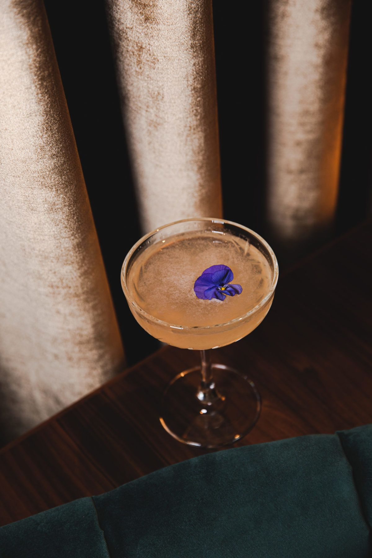 Cocktail in Coupe Glass with purple flower