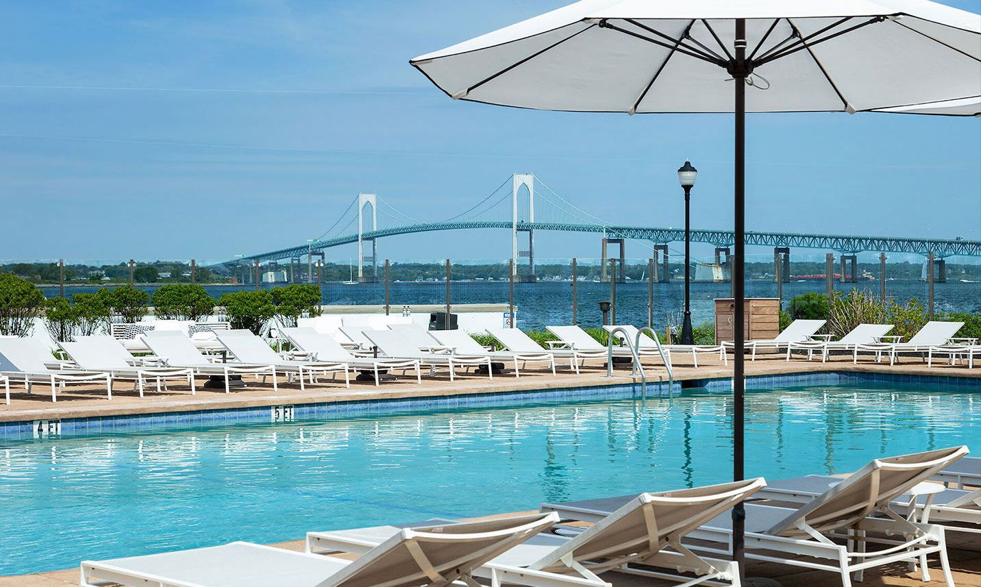Pool at Pineapple Club in Newport with view of the bridge