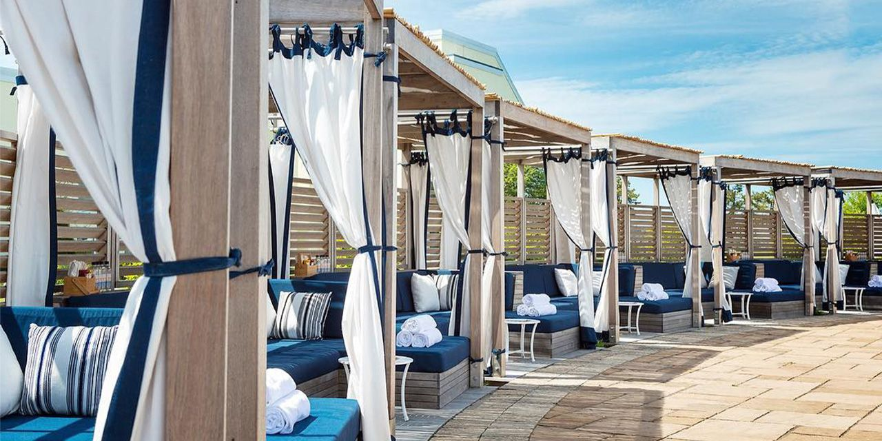 White and blue pool cabanas at the Pineapple Club